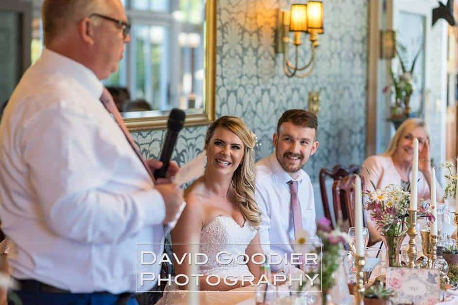 Bride & Groom sat at rustic wedding table setting at broadoaks country House Father's speech