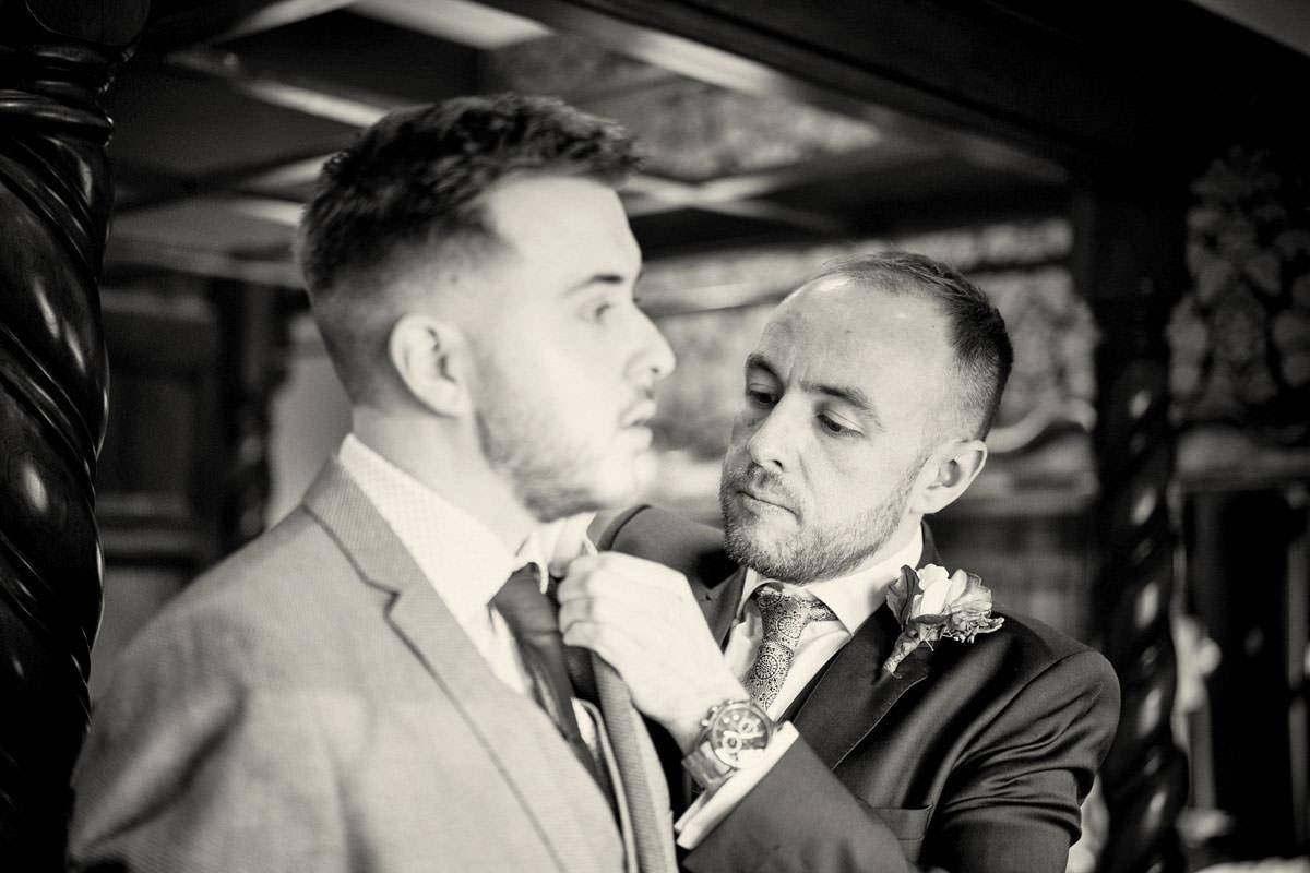 Two grooms preparing for their wedding day in the Boudoir