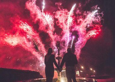 Couple watch fireworks display at Lake District Wedding venue Broadoaks
