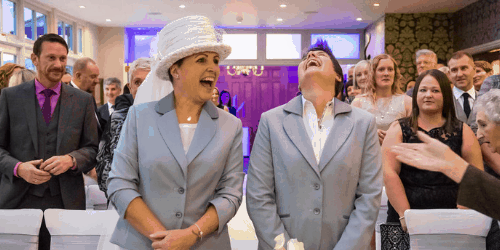 Same sex couple get married at Broadoaks laughing