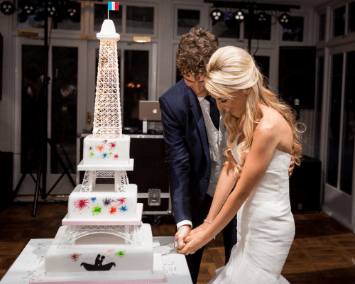 Couple cut wedding cake