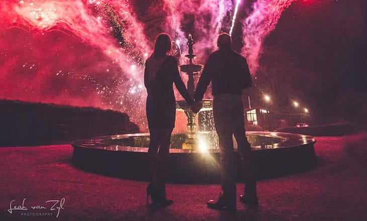 Couple watch fireworks display at Lake District Wedding venue Broadoaks